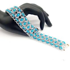 Hand woven chainmaille/chainmail bracelet in turquoise anodized and bright aluminium.