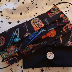Face mask and matching bag.  Musical instruments print cotton fabric