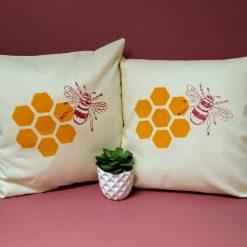 Block printed honeycomb and bee design cushion.