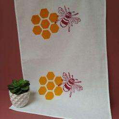 Hand printed bee and honeycomb tea towel
