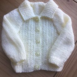Knitted baby jacket cream