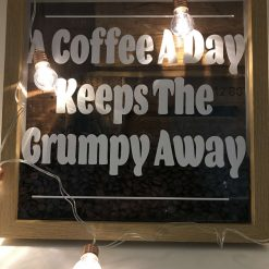Framed coffee quote, a coffee a day keeps mr grumpy away, with real beans inside.