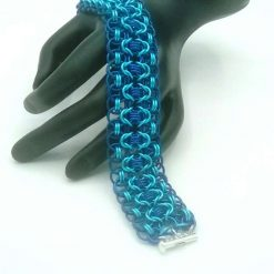 Hand woven Chainmaille/Chainmail Bracelet in turquoise and blue anodized aluminium.