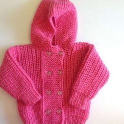 Hand knitted newborn baby jacket pink and glittery