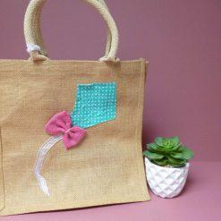 Appliqued kite design jute shopping bag