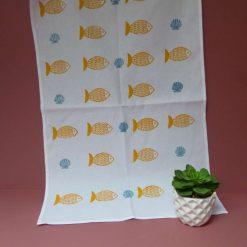 Hand printed fish and shell design cotton tea towel