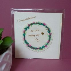 Hand painted flower wreath design 'Congratulations on your Wedding day' card.