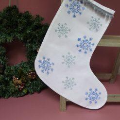 Hand printed Christmas stocking with pompom trim.