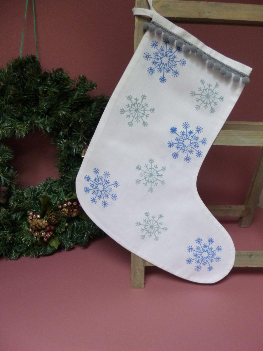 Hand printed Christmas stocking with pompom trim. 1