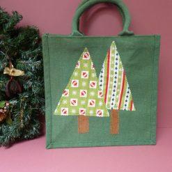 Hand embellished christmas tree jute bag.
