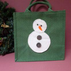 Hand embellished snowman jute bag.