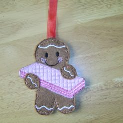 Gingerbread man holding malted milk biscuit