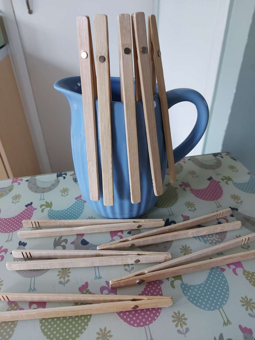 Bamboo toast tongs, with magnet to stick to toaster