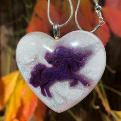 Unique unicorn heart resin pendant on a solid silver chain