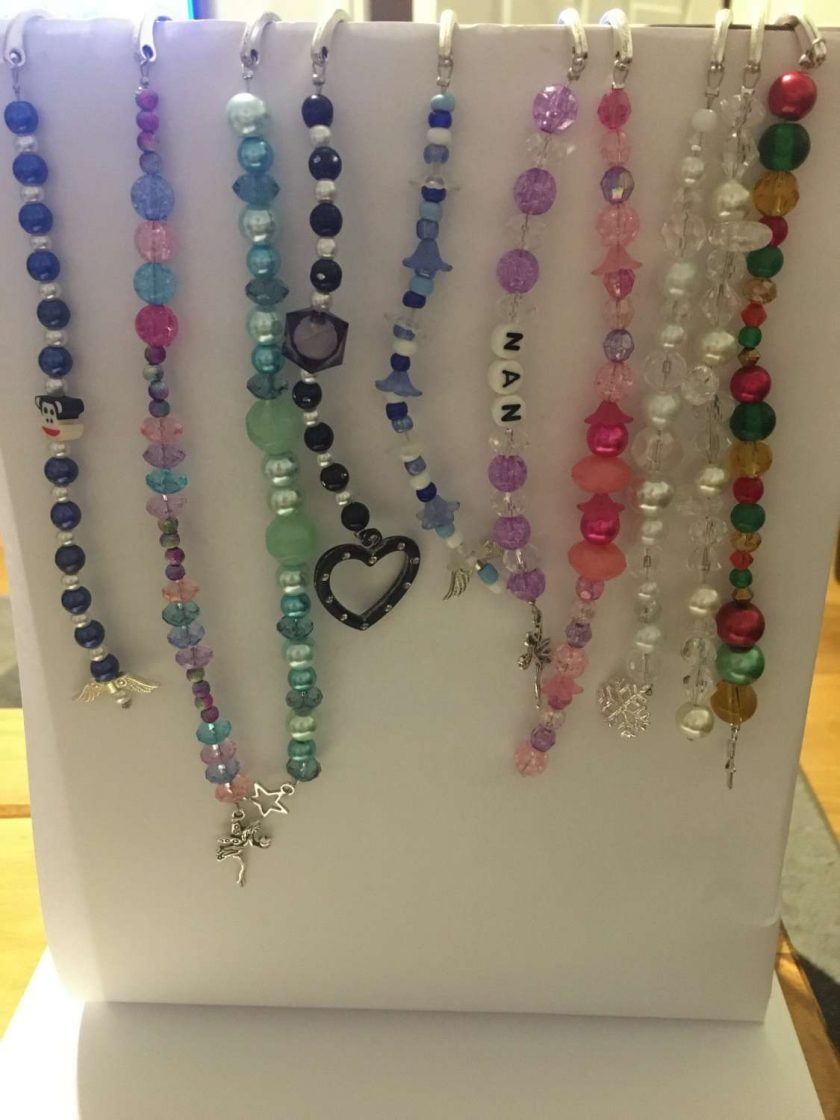 Beaded bookmarks with Tibetan charms 1