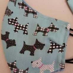 Scottie dogs on Blue  Design for these hand made cotton washable Face mask with 2 layers, ear elastic or ties in Size Small, Medium and Large. Free UK postage.