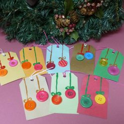 Christmas gift tags with button embellishments.