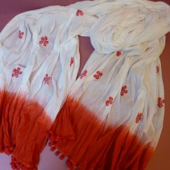 Long white cotton crinkle scarf with red poppies and pom pom trim.