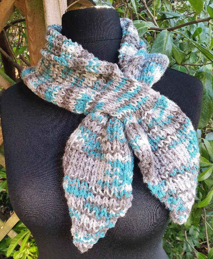 Handmade knitted keyhole scarf ....turquoise/neutral. 1