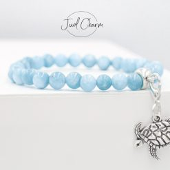 Handmade Aquamarine gemstone bracelet shown with a turtle charm
