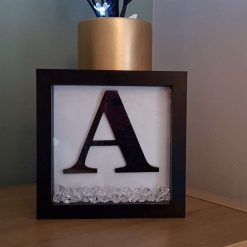 Box Framed initial with beautiful ice crystals.