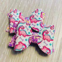 Pink dino bows x2