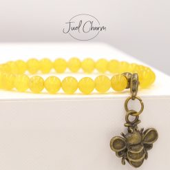 Handmade yellow Agate gemstone bracelet shown with a bee charm