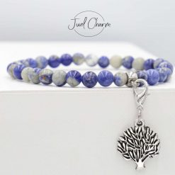 Handmade blue lace Agate gemstone bracelet shown with a tree of life charm