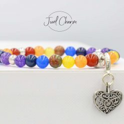 Handmade Chakra healing gemstone bracelet shown with a heart charm