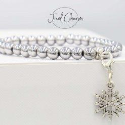 Handmade silver coated Hematite gemstone bracelet shown with a snowflake charm