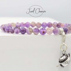 Handmade Amethyst gemstone bracelet shown with a teapot charm