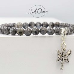 Handmade Larvikite gemstone bracelet shown with a fairy charm
