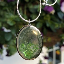 Unique handmade resin pendant, in a oval setting with solid silver chain
