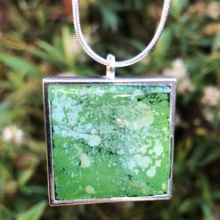 Unique handmade green resin pendant, in a square setting with solid silver chain