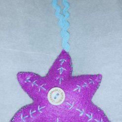 Handmade felt embroidered Christmas tree decorations.