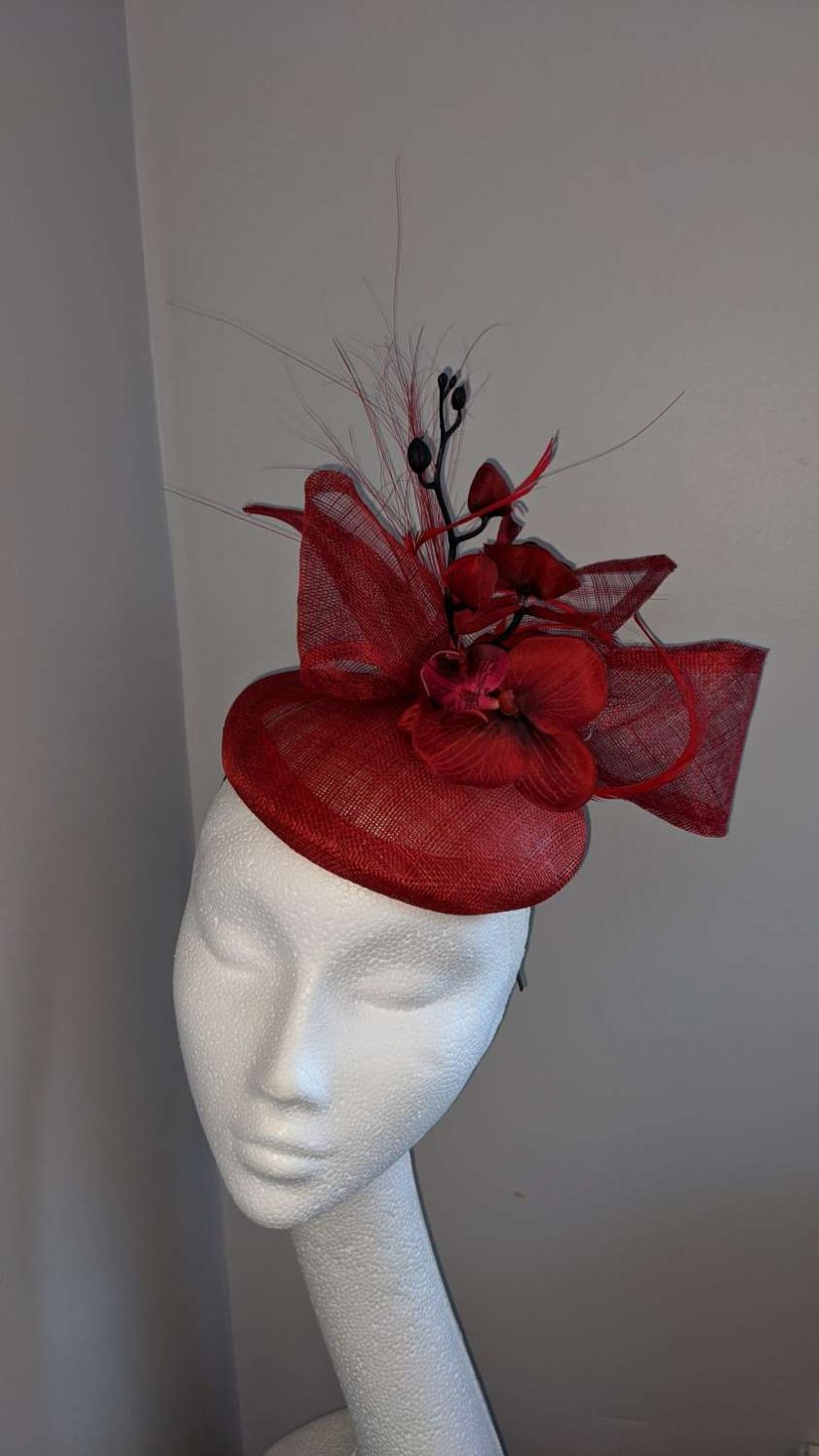 Red sinamay base fascinator with orchid on a headband , weddings and events 1