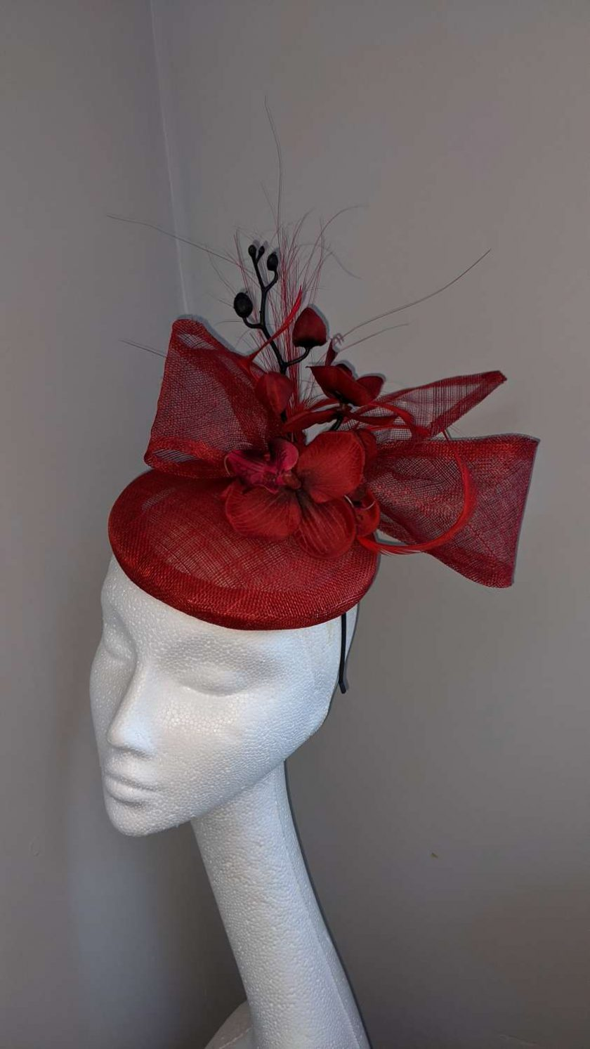Red sinamay base fascinator with orchid on a headband , weddings and events 2