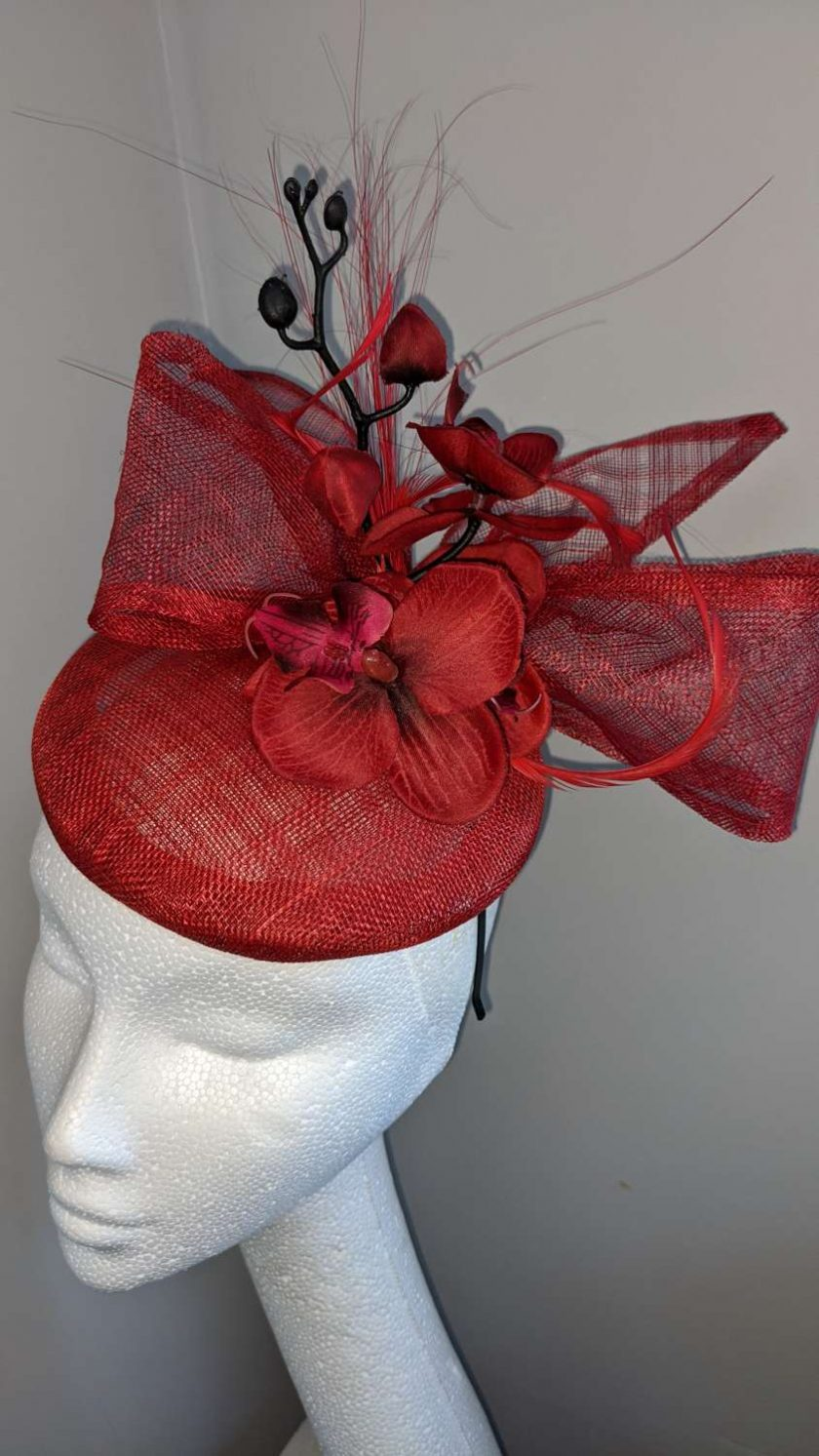 Red sinamay base fascinator with orchid on a headband , weddings and events 3