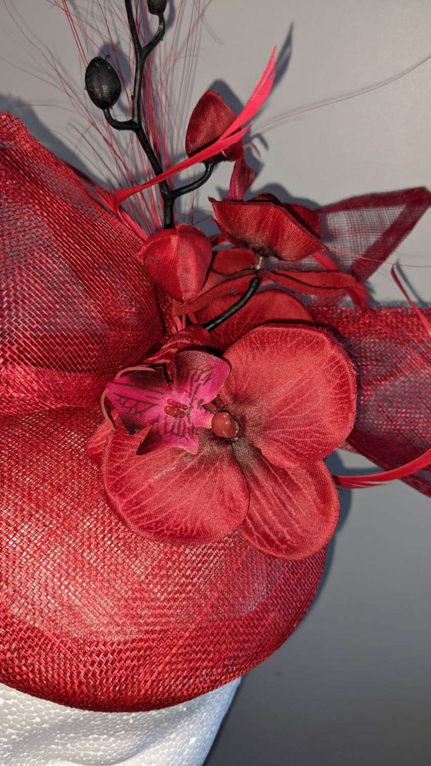 Red sinamay base fascinator with orchid on a headband , weddings and events 4