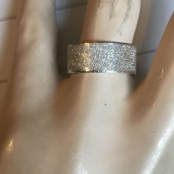 Gorgeous sterling silver ring with a bright sparkling textured finish  size P 5