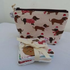 Cosmetic Bag with Christmas Sausage Dog Print from Sand Bags, St Ives by Naomi