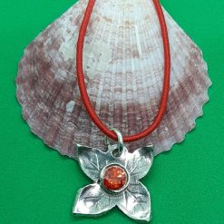 Fine silver flower pendant with red gem centre