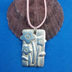 Fine silver rectangular pendant with layered flowers