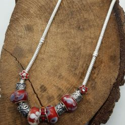 Charm necklace with silver-coloured & red charms