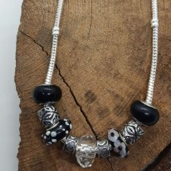 Charm necklace with silver-coloured & black charms