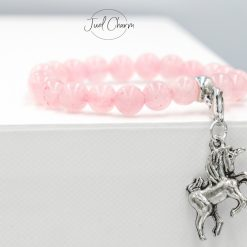 Handmade Rose Quartz gemstone bracelet shown with a unicorn charm