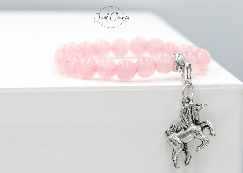 Handmade Rose Quartz gemstone bracelet shown with a unicorn charm